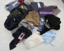 Large bag containing mixed clothing incl. shirts, polo shirts, trousers, etc.