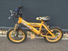 Small orange child's bike