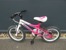 Pink and white Muddyfox child's bike