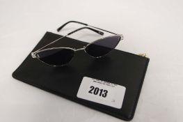 Pair of Stella McCartney sunglasses with case