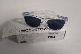 Pair of Oakley custom sunglasses
