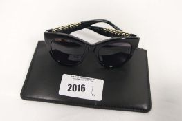 Pair of Stella McCartney sunglasses with carry case