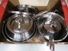 Tray containing mixed Kirkland pots and pans