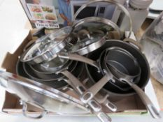 Tray of used Circulon pots and pans