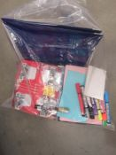 Bag containing mixed stationery, folders, notepads, pens, etc.