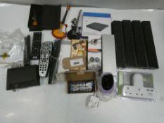 Bag containing remote controls, external CD drive, baby monitor camera, plug 2-way adapter, etc