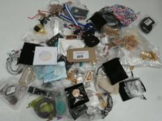 Small bag containing costume and dress jewellery