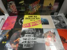 Box containing LP and 45 records to include Sex Pistols, Studio Killers, AC/DC, Dream Division and