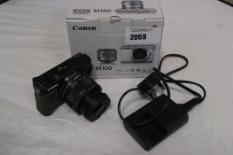 Canon EOS M100 camera with 15 - 45mm lens kit, charger and box