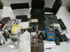 Bag containing electrical related devices/items; routers, remote controls, wireless earphones,