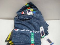 Bag containing ladies charcoal grey and blue t-shirts by Champion sizes ranging from XXL to M (