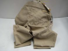Bag containing 12 pairs of ladies trousers by Andrew Marc, sizes predominantly 18