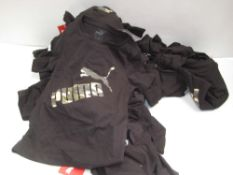Bag containing childrens Puma t-shirts in white and black with camouflage Puma motif to the front