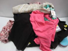 Bag of ladies clothing to include polka dot tops, Paisley tops, trousers, jean shorts, trainer