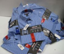 Bag containing 11 Kirkland Signature sports shirts