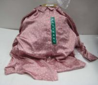 Bag containing 20 ladies polka dot tops in various sizes, colours to include predominantly pink