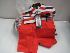 Bag containing 7 childrens shorts and polo shirt combinations by Andrew & Evan