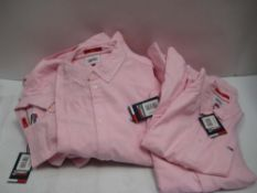 Bag containing gents Tommy Hilfiger Jeans pink shirts