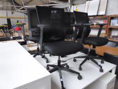 Black cloth and mesh swivel armchair