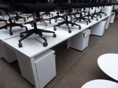 Bank of 6 Senator white 160cm workstations each with a mobile 3-drawer pedestals