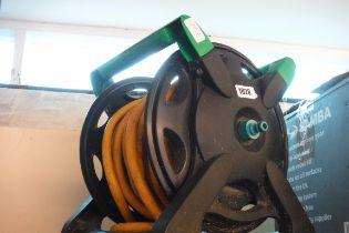 (1051) Garden hose on reel