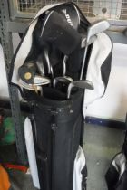 Black and grey Dunlop golf bag containing mixed branded golf clubs