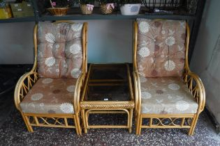 Cane conservatory suite comprising 2 armchairs and coffee table