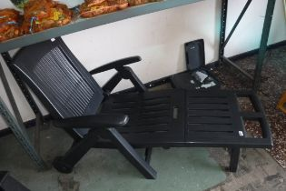 Black plastic garden collapsible sun lounger