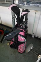 Ram golf bag in pink and black containing Ram girls golf clubs