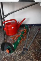 Black & Decker electric strimmer, red plastic watering can and pair of garden shears (fail)