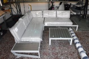 Grey and black aluminium framed L-shape garden sofa with cushions and coffee table