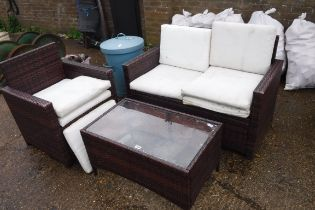 Rattan suite comprising 2 seater sofa, chair and glass top coffee table