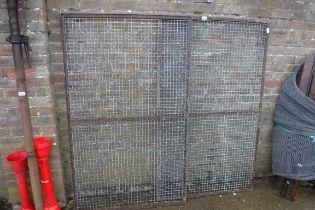Pair of metal cage doors