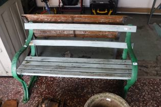 Wooden garden bench with cast iron bench ends