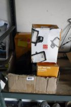 Box containing halogen outdoor lights
