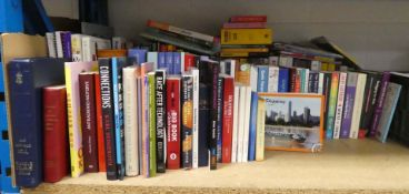 Shelf of hardback and paperback novels, reference materials etc for various publishers like