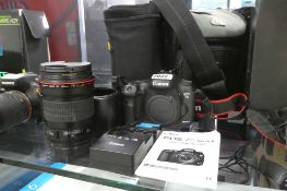 Canon EOS 7D Mk.II DSLR camera body together with Canon EF 135mm USM lens inc. lens hood, battery