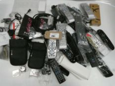 Bag containing quantity of remote controls and other miscellaneous accessories; headsets, cables,