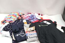 Bag of assorted childrens clothing incl. champion t-shirts, summer dresses with floral decoration