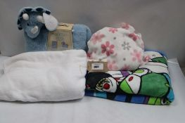 Bag of mixed childrens throws and Snuggle Me Too blankets