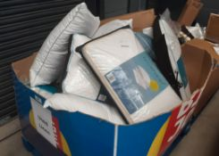 Pallet of used pillows and duvets