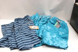 Large bag of assorted Kirkland swim wear with floral and striped fabric