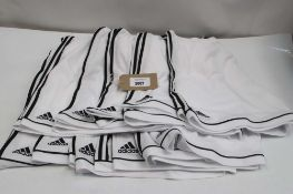 10 pairs of Climalite shorts in white with black stripe