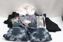 Bag of assorted gents clothing incl. floral shirts, Tommy jean shirts, jeans, Calvin Klein underwear