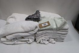 Bag of mainly white toweling towels