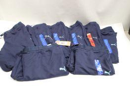 8 pairs of Puma ladies light weight tracksuit bottoms in dark blue