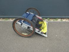Bike trailer with yellow and blue canopy