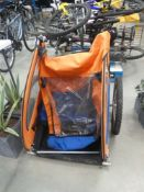 Bike trailer with orange and blue canopy