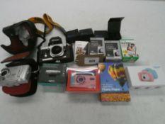 Bag containing various cameras and camera accessories