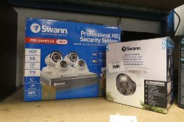 Swan Professional HD security system with a loose security camera in box